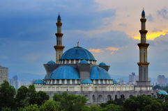 The Federal Territory mosque, Kuala Lumpur Malaysia during sunrise. The Kuala Lumpur Mosque was constructed between 1998 to 2000. It is situated on a five Stock Photography