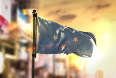 Federated States of Micronesia Flag Against City Blurred Backgro Stock Images