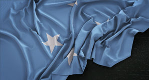 Federated States of Micronesia Flag Wrinkled On Dark Background Stock Images