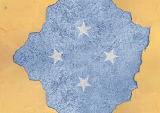Federated States of Micronesia flagga i stor betong knäckt hål arkivbilder