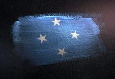 Federated States of Micronesia flagga som göras av metallisk borstemålarfärg arkivfoto