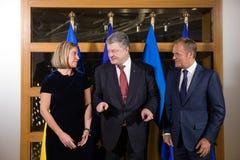 Federica Mogherini, Petro Poroshenko en Donald Tusk stock foto's