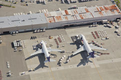 FedEx Airliners Unloading at Busy Airport. Aerial view of two FedEx airplanes loading and unloading at Seattle-Tacoma International Airport Royalty Free Stock Images