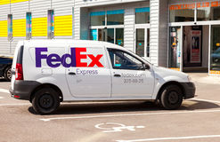 FedEx delivery car parked up on the city street in summer sunny Stock Photos