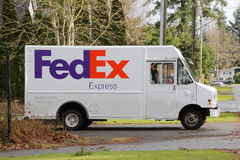 Fedex Delivery Truck in Neighborhood Stock Images