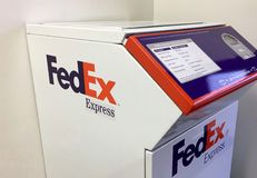 FedEx express drop box self service. Worldwide FedEx express delivery drop box self service at shipping center. FedEx Corporation is an American global courier Royalty Free Stock Image