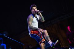 Fedez singing live on stage. Lucca, italia - july 13, 2017: Fedez he performs on stage during a summer music festival royalty free stock image