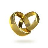Fedi nuziali dorate in una forma di un cuore Fotografie Stock Libere da Diritti