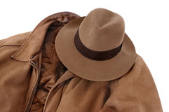 Brown leather jacket and fedora hat isolated on white background Stock Image