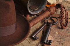 Fedora hat, bullwhip and relics Royalty Free Stock Image