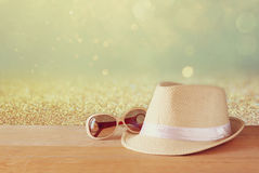 Fedora hat and sunglasses over wooden table. relaxation or vacation concept Stock Photography