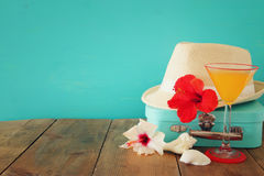 Fedora hat, sunglasses, tropical hibiscus flower on wooden table Royalty Free Stock Photos