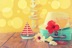 Fedora hat, tropical hibiscus flower on wooden table. relaxation or vacation concept Royalty Free Stock Photo
