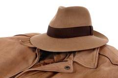Old Fedora hat, leather jacket, isolated on white background Royalty Free Stock Photos