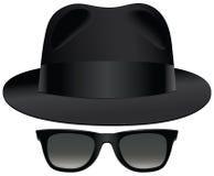 Fedora sunglasses. A classic set of black fedora and sunglasses Royalty Free Stock Photo