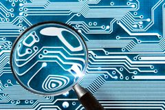 Fee Computer - computer security system and a magnifying glass Royalty Free Stock Images