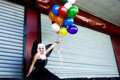 Fee met ballons royalty-vrije stock afbeeldingen