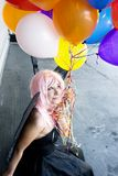 Fee mit Ballonen Stockbild