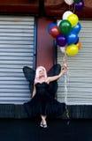 Fee mit Ballonen Stockfotografie