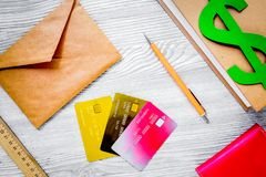 Fee-paying education set with dollar sign, books and cards on li Stock Images