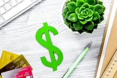 Fee-paying education set with dollar sign, books and cards on li royalty free stock photography
