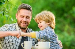 Feed baby. Natural nutrition concept. Fathers day. Best friends. Father and son having fun. Feeding son natural foods. Healthy food. Father and boy drink tea stock images