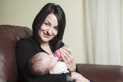 Feed baby Stock Photos