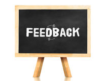 Feed back word on blackboard at white background Stock Photo
