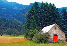 Feed barn with red door.  Stock Image