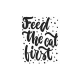 Feed the cat first - hand drawn dancing lettering quote isolated on the white   Royalty Free Stock Photography