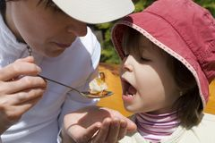 Feed of child. Help by eat Stock Images