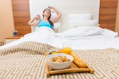 Feed healthy breakfast in bed Royalty Free Stock Photos