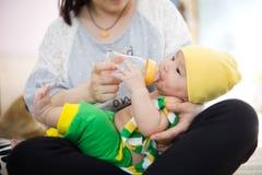 Feed milk to baby Royalty Free Stock Photos