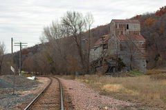 Feed Mill on Railroad Tracks Stock Photography
