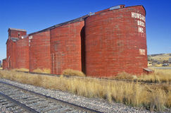 Feed Silos by train tracks in rural MT Stock Photography