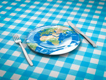 Feed the world. Fork knife and plate with earth map on it Stock Photos