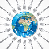 Feed the world. Hand shape forks with earth plate on white background Royalty Free Stock Images