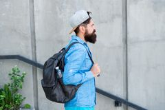 Feed your wanderlust. Mature hipster with beard traveller. Bearded man. Confident brutal man walk street. Male barber. Care. brutal hipster with travel backpack royalty free stock photo