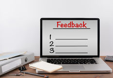 Feedback Blank List. Office desk with a laptop. Royalty Free Stock Image