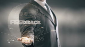 Feedback Businessman Holding in Hand New technologies. Businessman in the future with futuristic technology stock footage