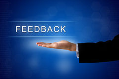 Feedback button on virtual screen Stock Photography