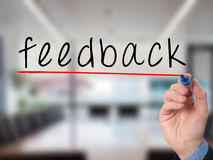 Feedback concept with businessman hand writing Stock Photography