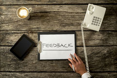Feedback Concept on a Clipboard on Top of a Table Royalty Free Stock Photo