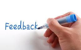 Feedback Concept. Hand writing Feedback with blue marker on paper stock photos