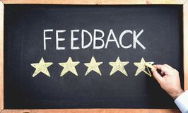Feedback Concept, Man Filling In Rating Stars. On Blackboard royalty free stock photos