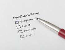 Feedback form checked with excellent. Feedback form filled with satisfaction Royalty Free Stock Image