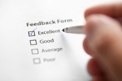 Feedback form checked with excellent. Feedback form filled with satisfaction Stock Photography