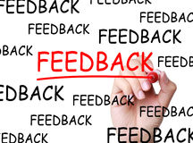 Feedback. Hand writing Feedback concept with red marker on transparent wipe board Stock Photography