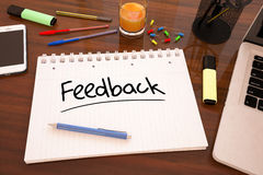 Feedback. Handwritten text in a notebook on a desk - 3d render illustration Royalty Free Stock Photo
