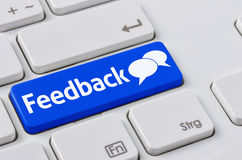 Feedback. A keyboard with a blue button - Feedback stock photography